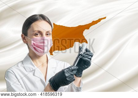 Girl Doctor Prepares Vaccination Against The Background Of The Cyprus Flag. Vaccination Concept Cypr