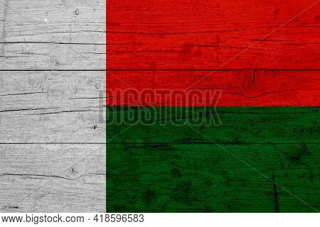 Flag Of Madagascar. Wooden Texture Of The Flag Of Madagascar.