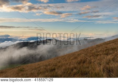 Evening In The Mountains. Cloud Level View. Evening Landscape With Clouds. Landscape In The Mountain
