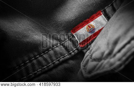 Tag On Dark Clothing In The Form Of The Flag Of The French Polynesia