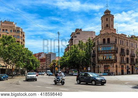 PALMA, SPAIN - MAY 09, 2019: View of urban road and buildings under blue sky in Palma - capital and largest city of Balearic islands, famous resort and tourist destination.