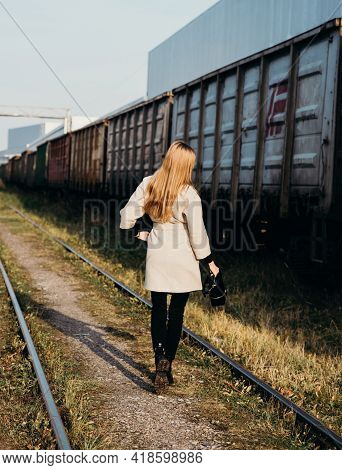 Young Woman Girl Hanging On The Wagon Of A Freight Freight Train Green. Transportation, Transportati