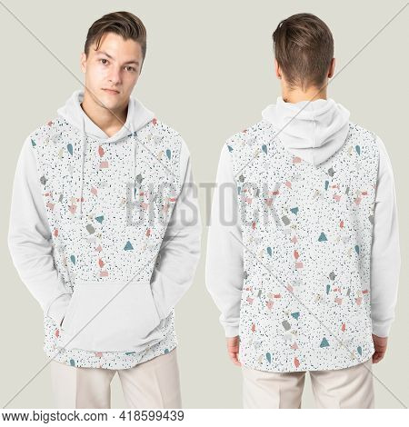 Handsome man wearing printed hoodie for winter fashion studio shoot rear view