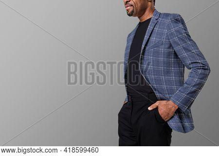 African American man wearing flannel blazer