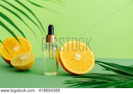 Cosmetic Serum Vitamin C In Glass Bottle With Pipette Dropper. Orange Essential Oil With Citrus Ingr