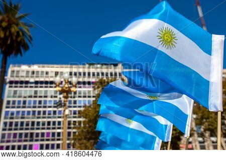 Soft focused Argentine flags at Plaza de Mayo in Buenos Aires