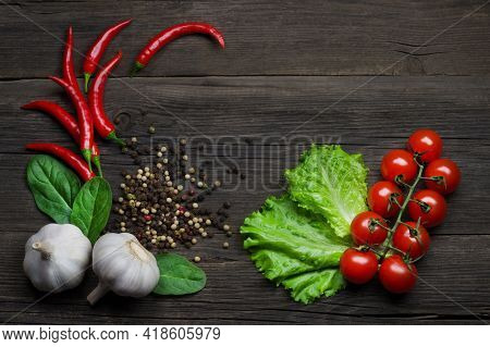 Ripe Vegetables Ingredients For Cooking. Red Hot Chili Peppers, Cherry Tomatoes, Aromatic Garlic, Al