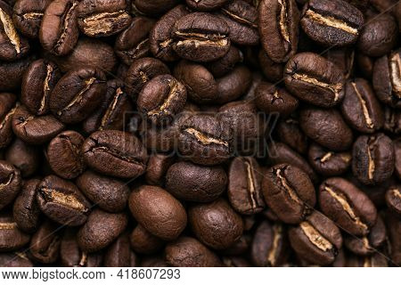 Brown Roasted Coffee Beans. Closeup Shot Of Coffee Beans