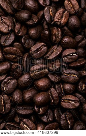 Brown Roasted Coffee Beans. Closeup Shot Of Coffee Beans.