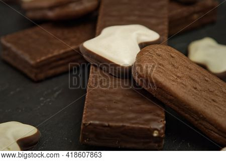 A Piece Of Cake Sitting On Top Of A Wooden Cutting Board. High Quality Photo