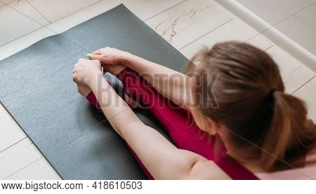 Healthy Woman Sit On Mat In Paschimottanasana Pose, Doing Breathing Exercises, Indoor, Home Interior