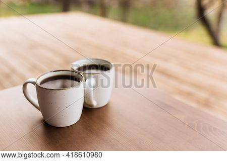 Two Cups Of Coffee On The Table On The Wooden Brown Terrace. Relaxation, Silent Country Side Life Co