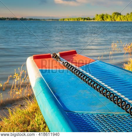 stand up paddleboard (SUP) with a safety leash on a lake shore in Colorado (Boyd Lake State Park), summer scenery