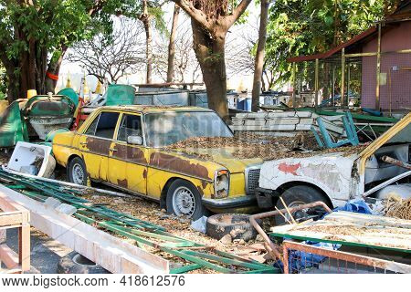 Old Rusty Wreck Car And The Waste Of Construction Materials Equipment