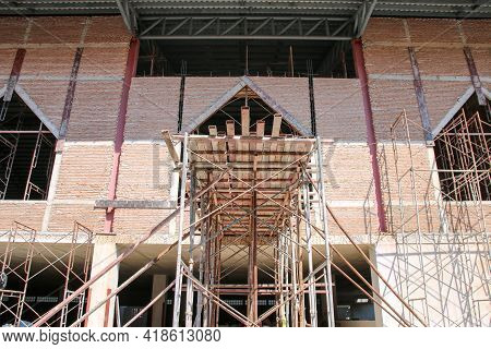 Steel Scaffolding Of Building At Construction Site