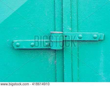 Green Painted Obsolete Metal Garage Gate With Armored Lock Housing. Detail Of Lock System