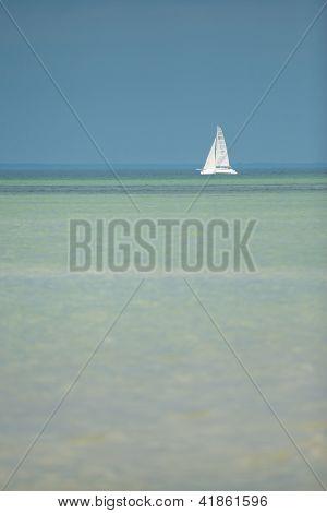 lone sailboat on the horizon
