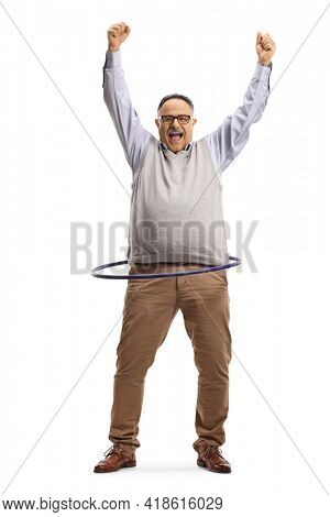 Full length portrait of a cheerful mature man spinning a hula hoop and lifting arms up isolated on white background