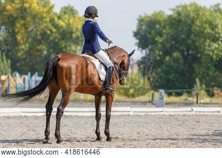 Teenage Horse Rider Girl Finish Her Dressage Test