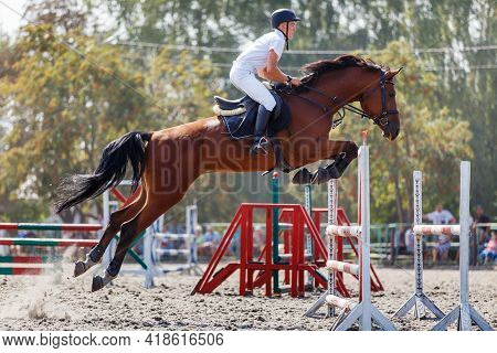 Young Man Jumping Horse On His Show Jumping Course