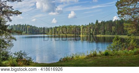 Beautiful forest lake in Russia. Panoramic view of beautiful lake landscape in Pskov region, Russia.
