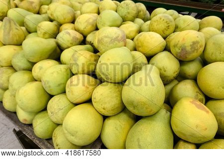 group of pomelo fruit in a traditional marketplace
