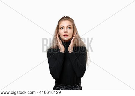 Portrait Of Shocked Young Woman Holding Hands Near Face, Looking Concerned And Nervous, Standing Tro