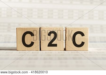 C2c Abbreviation - Consumer To Consumer, On Wooden Cubes On A Light Background.