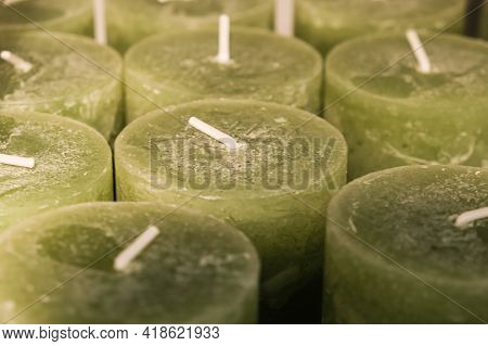 Close-up Of Thick Green Wax Candles In Shop. Warehouse Of Handmade Scented Candles. Production Of De