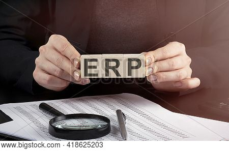 Erp Enterprise Resource Planning On The Wooden Block.leadership Strategy Management Finance Business