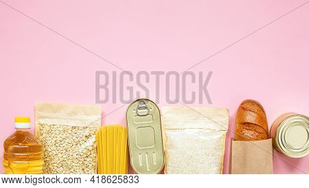Donation Food On Pink Background With Copy Space.flat Lay.rice, Canned, Oat Flakes, Oil, Baguette, P