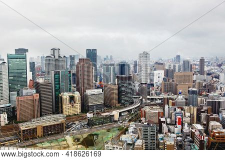 Osaka, Japan - 18 May, 2015: View From Above On Osaka City With Skyline With Skycrapers, Highways An