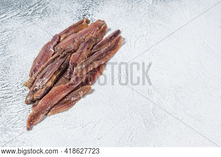 Canned Anchovies Fish Fillet In Olive Oil. White Background. Top View. Copy Space