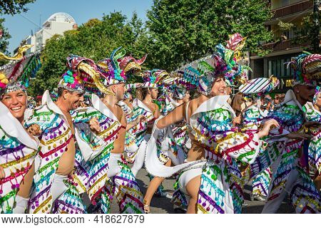 LGTBQ Pride Festival celebration. Barcelona - Spain. June 29, 2019: A group of dancing man and women in latinamerican gay-colored dresses and wide brim hats