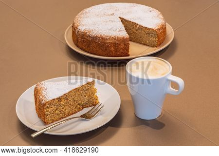 Old Recipe Cake Made From Almonds And Dry Bread (antica Torta Alle Mandorle E Pane) With A Cup Of Ca