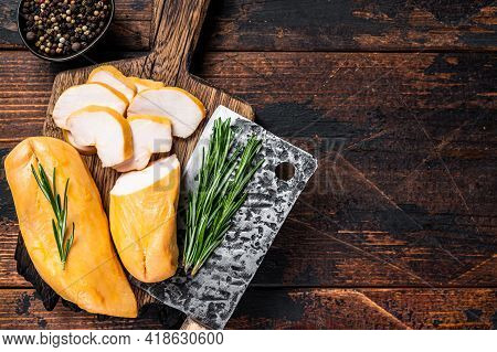 Sliced Smoked Chicken Breast Fillet Meat On A Butcher Board. Dark Wooden Background. Top View. Copy
