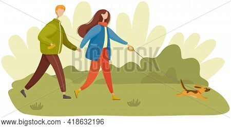 Young Couple In Warm Clothes Walks With Little Dog In Park. Long Hair Woman Holds Dog Leash. Outdoor