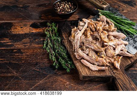 Slow Cooked Puilled Pork Meat On A Wooden Board With Butcher Cleaver. Dark Wooden Background. Top Vi