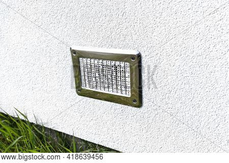 Air Intake From The Manor To The Fireplace With A Closed Combustion Chamber, Silver Grille On The Fa
