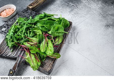 Fresh Mixed Greens, Spinach, Swiss Chard And Arugula. White Background. Top View. Copy Space