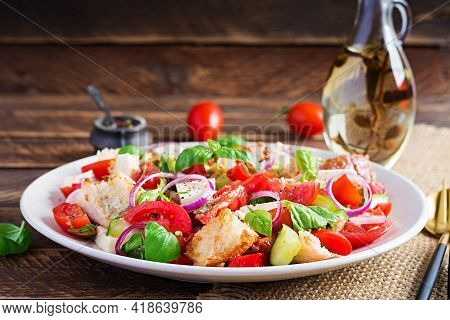 Tuscan Panzanella, Traditional Italian Salad With Tomatoes And Bread On Wooden Background. Vegetaria
