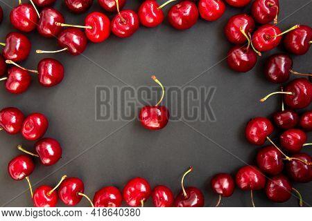 Background Of Ripe Bright Red Cherries. Cherries Isolated On Dark Background. Close-up Of Cherries.