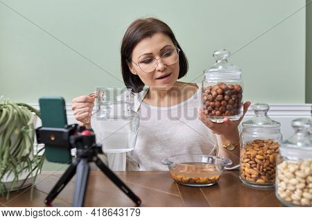 Nutritionist Talks About Benefits Of Soaking Nuts In Water, Recording Video Blog Vlog