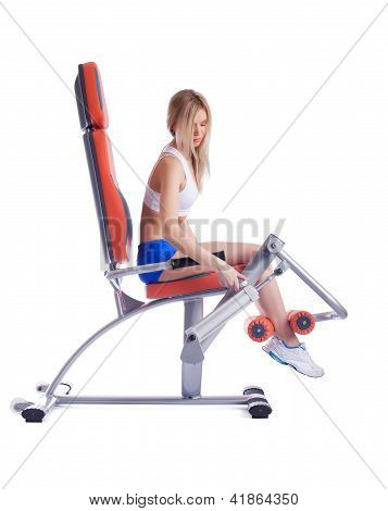 Blonde young woman ajustment exerciser isolated