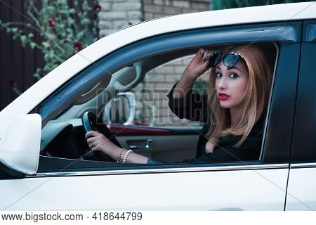 Business Woman In A Car, Auto Lady Concept. Stylish Lady Sit In Automobile