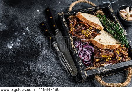 Pulled Pork Sandwich With Smoked Pork Meat In A Wooden Tray. Black Background. Top View. Copy Space