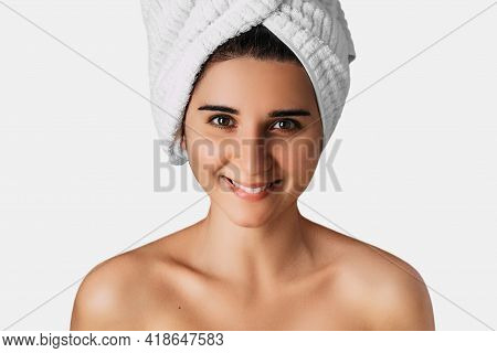 Portrait Of Young Pretty Girl Smiling With Towel On Her Head. Woman With Towel On Her Head, Close-up