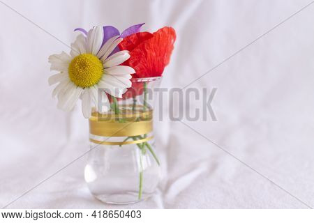Bunch Of Beautiful Wildflowers In A Glass Vase On White Background.space For Text.