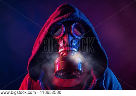 Red And Blue Illuminated Person Is Wearing A Gas Mask