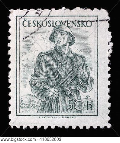 ZAGREB, CROATIA - SEPTEMBER 18, 2014: Stamp printed in Czechoslovakia shows Soldier, Professions series, circa 1954
